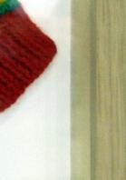 Knitted Child's Rastafarian Top Framed in Oak